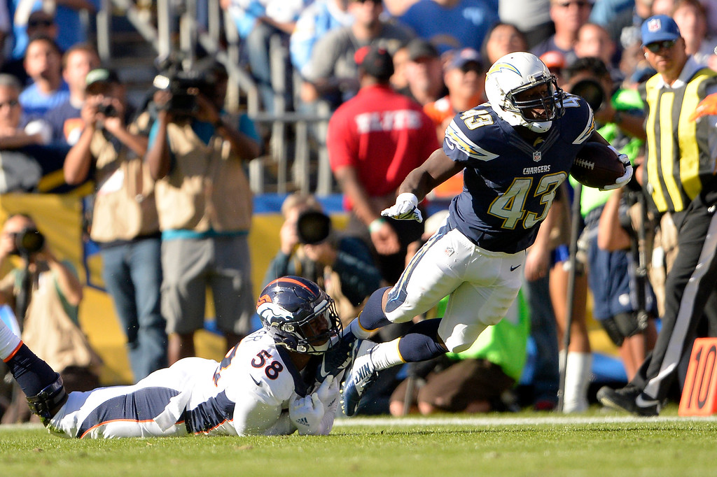 . SAN DIEGO, CA. December 14, - outside linebacker Von Miller #58 of the Denver Broncos snags running back Branden Oliver #43 of the San Diego Chargers at Qualcomm Stadium December 14, 2014 San Diego, CA (Photo By Joe Amon/The Denver Post)
