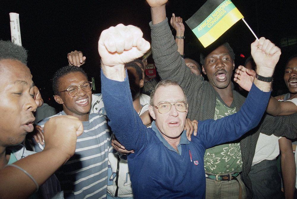 Description of . Supporters of the African National Congress celebrate in the streets of Johannesburg, South Africa, Monday, May 2, 1994, following the victory celebration by Party Leader Nelson Mandela. Mandela and the ANC appear set to take power following last week's historic all-race elections. (AP Photo/Michael Yassukovich)