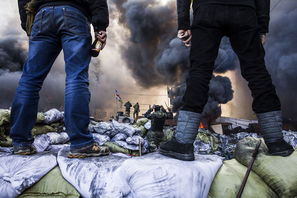 . Anti-government demonstrators stand on barricades during clashes with riot police in Kiev on February 18, 2014.   AFP PHOTO / SANDRO MADDALENA/AFP/Getty Images