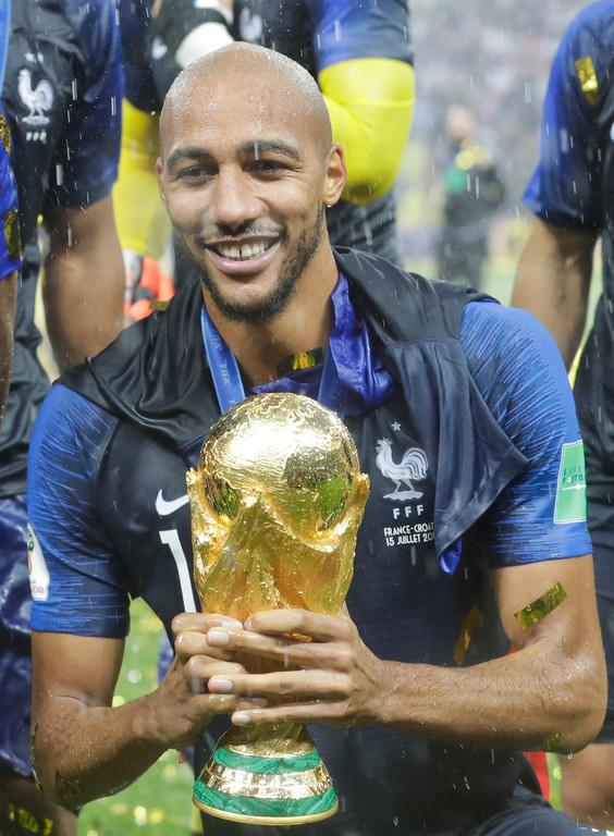 . France\'s Steven Nzonzi poses with the trophy after the final match between France and Croatia at the 2018 soccer World Cup in the Luzhniki Stadium in Moscow, Russia, Sunday, July 15, 2018. (AP Photo/Matthias Schrader)