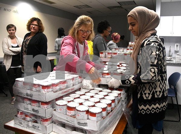 11/16/2017 Mike Orazzi | Staff Bristol Hospital WIC Program nutritionists Karen Lombardi and Fatima Hussain while packaging food for area needy on Prospect Street Thursday morning. Staff assembled Thanksgiving food packages for local families courtesy of donations from the Bristol Hospital Medical Staff.