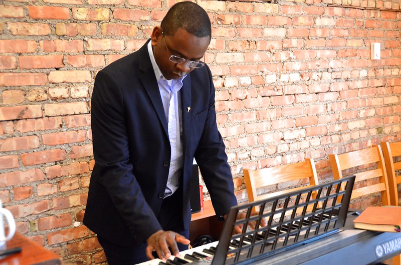 Fr. Joseph warms up on the keyboard