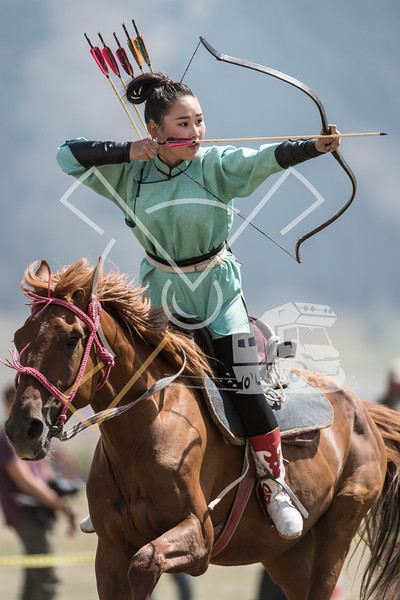 Female horseback archer during a competition at the World Nomad Games 2018 in Kyrgyzstan.