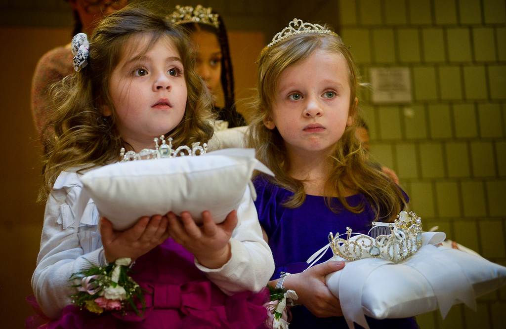 . Four-year-olds Madeline Flynn, left, and Makenna Flaherty wait to be introduced as the honorary gift bearers at the start of the Senior Royalty Coronation ceremony. (Pioneer Press: Ben Garvin)