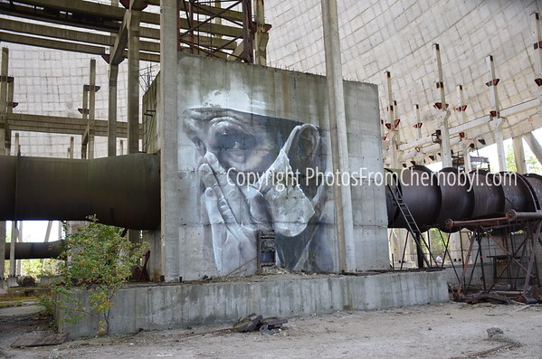 Beautiful graffiti image of man with a mask. Inside the cooling tower of Reactor 5, Chernobyl Nuclear Power Plant, Ukraine.