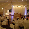 Snowflake Wedding- Decorated Backdrop, Head Table and Lighted Cake Table with a Snowflake Canopy Dance Floor.  The linens and chairs are cream with chocolate brown satin sashes.  Maneeley's in South Windsor, CT