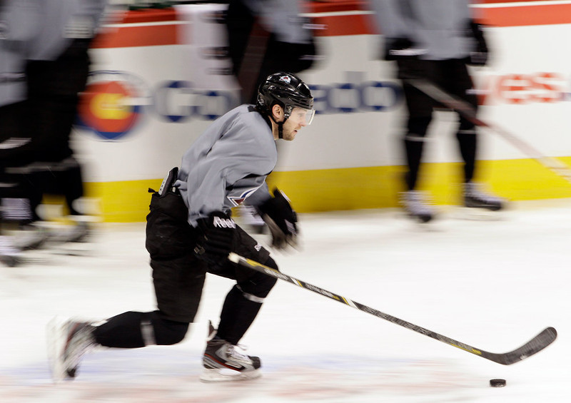 . Colorado Avalanche\'s Mark Olver controls the puck during NHL hockey practice, Thursday Jan. 17, 2013, in Denver, Colo. (AP Photo/Brennan Linsley)
