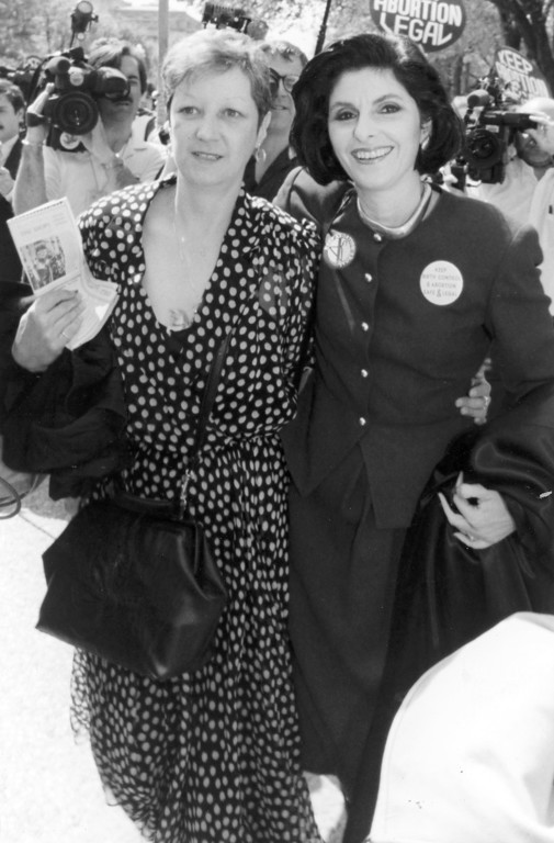 . Norma McCorvey, left, who was Jane Roe in the 1973 Roe vs. Wade Supreme Court case which gave women the right to an abortion, walks with her attorney, Gloria Allred, outside the Supreme Court in April 1989, where they observed the high court as it heard arguments in a case which could overturn the Roe vs. Wade decision. (AP Photo/J. Scott Applewhite)