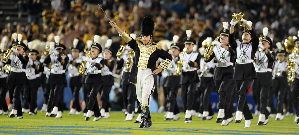 . The California band enters field prior to their college football game against UCLA in the Rose Bowl in Pasadena, Calif., on Saturday, Oct. 12, 2013.   (Keith Birmingham Pasadena Star-News)
