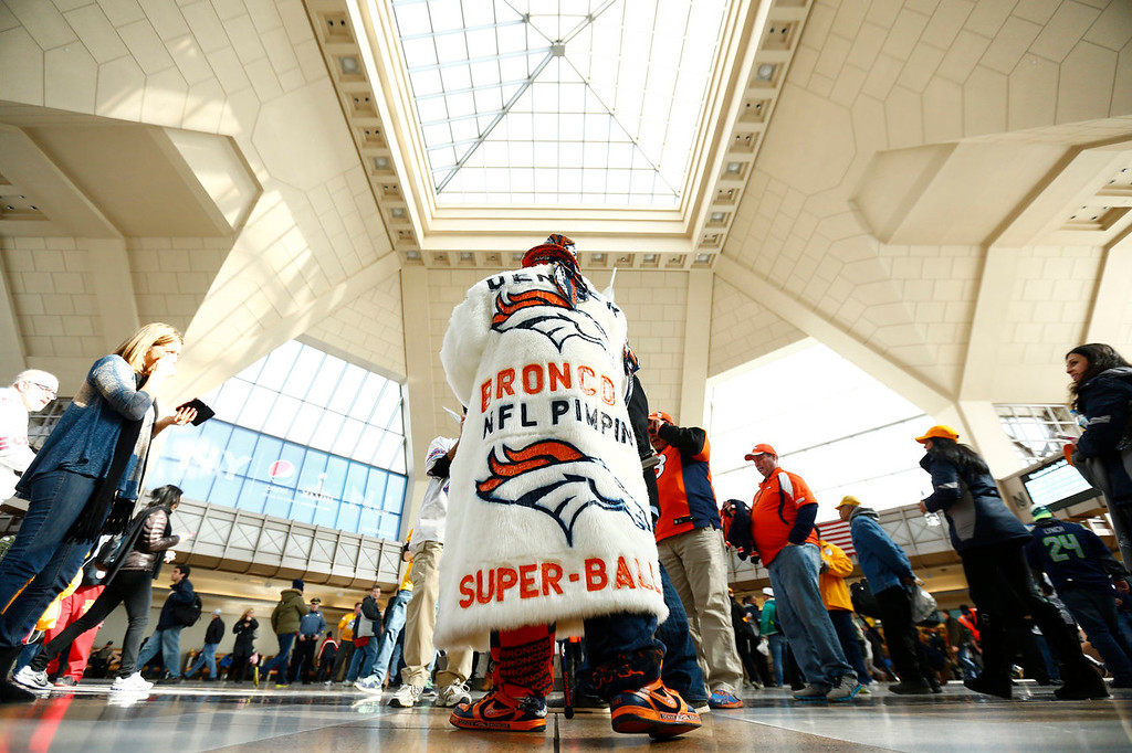 . A football fan walks through at the Secaucus Junction, Sunday, Feb. 2, 2014, in Secaucus, N.J. The Seattle Seahawks are scheduled to play the Denver Broncos in the NFL Super Bowl XLVIII football game on Sunday evening at MetLife Stadium in East Rutherford, N.J. (AP Photo/morry gash)