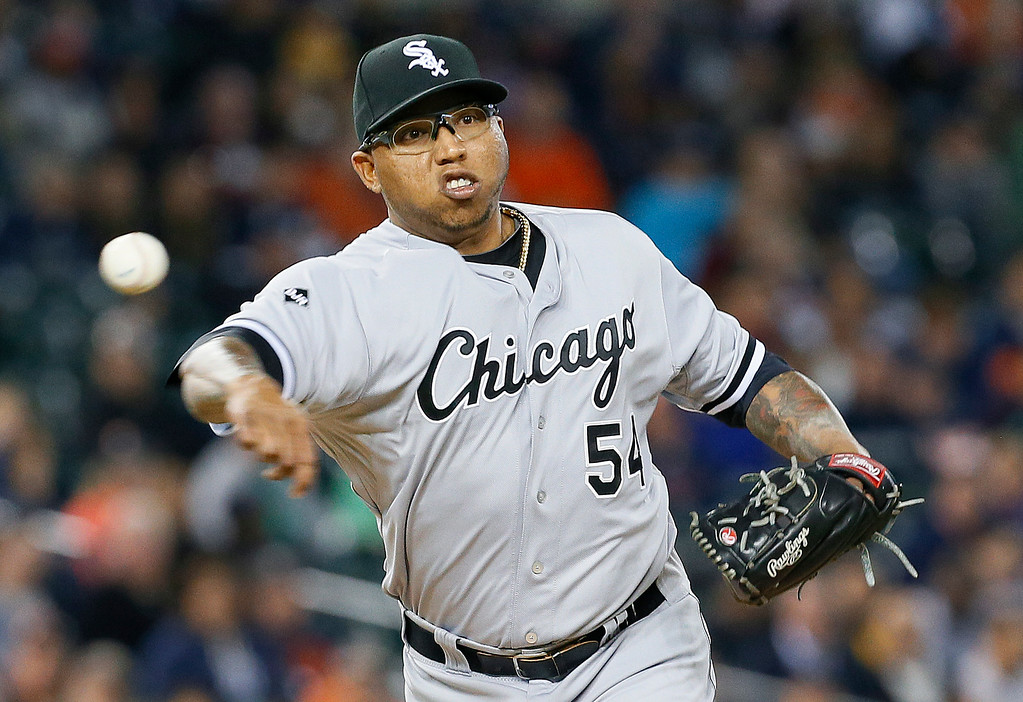 . Chicago White Sox relief pitcher Ronald Belisario throws to first base against the Detroit Tigers in the seventh inning of a baseball game in Detroit Tuesday, Sept. 23, 2014. (AP Photo/Paul Sancya)