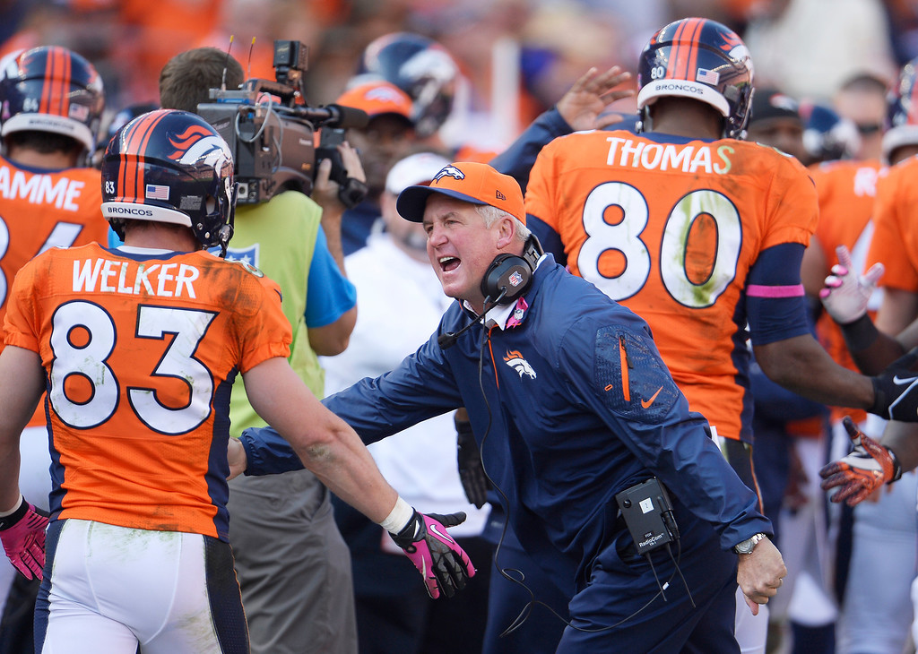 . Denver Broncos wide receiver Wes Welker (83) is congratulated by Denver Broncos head coach John Fox in the third quarter. The Denver Broncos take on the Jacksonville Jaguars at Sports Authority Field at Mile High in Denver on October 13, 2013. (Photo by Joe Amon/The Denver Post)
