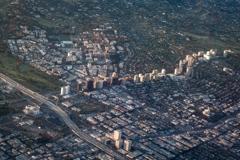 June 11 - UCLA, and Westwood and more from the left side of the plane while landing at dusk in Los Angeles.jpg