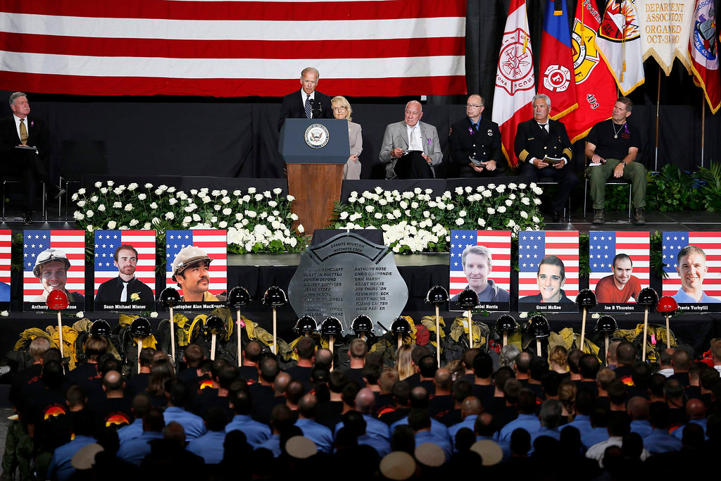 . U.S. Vice President Joe Biden speaks at a memorial service for the fallen members of the Granite Mountain Hotshots, in Prescott Valley, Arizona July 9, 2013. Thousands of mourners, including firefighters from around the country and Biden, converged in central Arizona on Tuesday to pay final tribute to 19 young firemen killed last week in the line of duty. REUTERS/Lucy Nicholson
