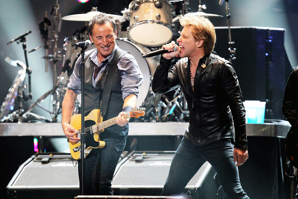 . This image released by Starpix shows Bruce Springsteen, left, and Jon Bon Jovi performing at the 12-12-12 The Concert for Sandy Relief at Madison Square Garden in New York on Wednesday, Dec. 12, 2012. Proceeds from the show will be distributed through the Robin Hood Foundation. (AP Photo/Starpix, Dave Allocca)