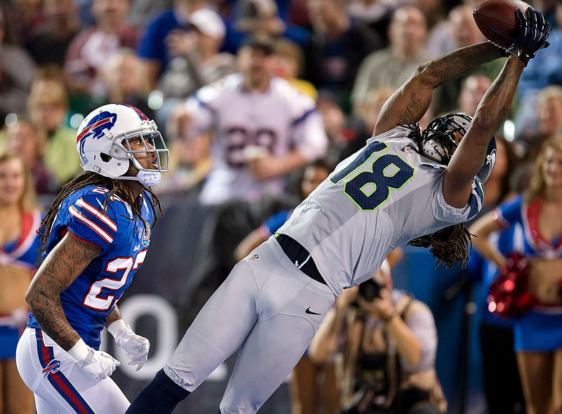 . Seattle Seahawks wide receiver Sidney Rice (18) tries to haul in a touchdown pass against Buffalo Bills cornerback Stephon Gilmoure (27) during the second half of an NFL football game, Sunday, Dec. 16, 2012, in Toronto. The pass was ruled incomplete. The Seahawks won 50-17. (AP Photo/The Canadian Press, Frank Gunn)