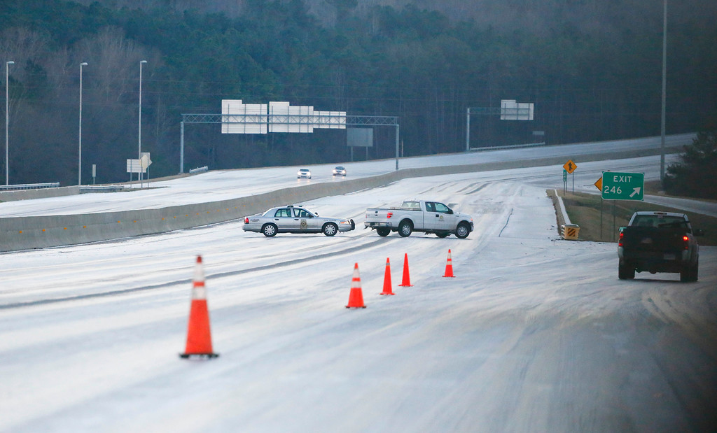 . Road blocks redirect traffic blocking off sections of the ice covered interstate heading south near Birmingham, Ala., Saturday, Jan. 7, 2017. (AP Photo/Brynn Anderson)