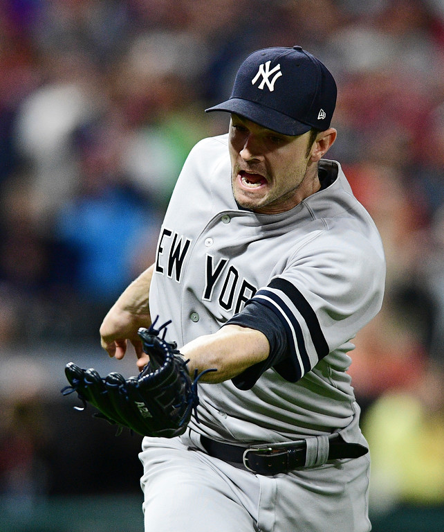 . New York Yankees relief pitcher David Robertson catches a fly ball hit by Cleveland Indians\' Jason Kipnis during the sixth inning of Game 5 of baseball\'s American League Division Series, Wednesday, Oct. 11, 2017, in Cleveland. (AP Photo/David Dermer)