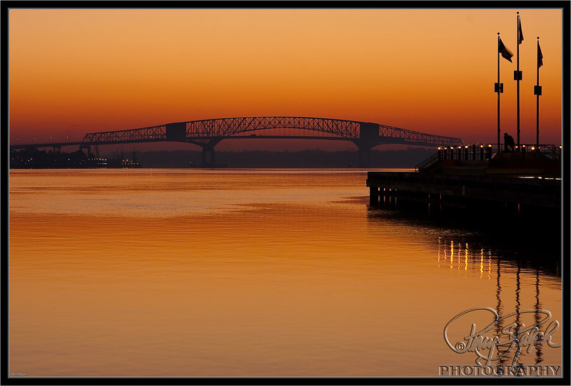 Hart Bridge at Sunrise.  Jacksonville, FL early morning wake up call saw this bright orange sky over the St. John River.  I went out and show the Hart Bridge.  It was strange to me since i thought the river ran north/south and i was up river from the bridge.  Overall it was a beautiful sunrise.
