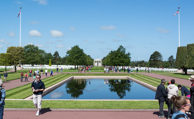 The memorial faces a chapel across a reflecting pool
