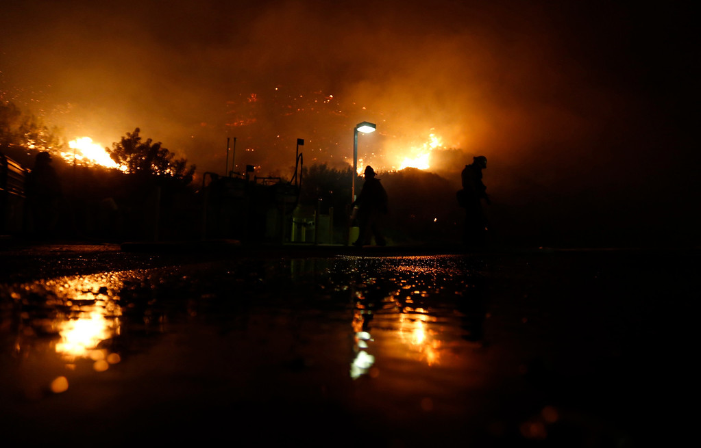 . Firefighters battle to protect a CalTrans Maintenance Station and Fuel Depot from the Springs Fire near Pacific Coast Highway and the Los Angeles County Line at Malibu, California, May 2, 2013. REUTERS/Patrick T. Fallon