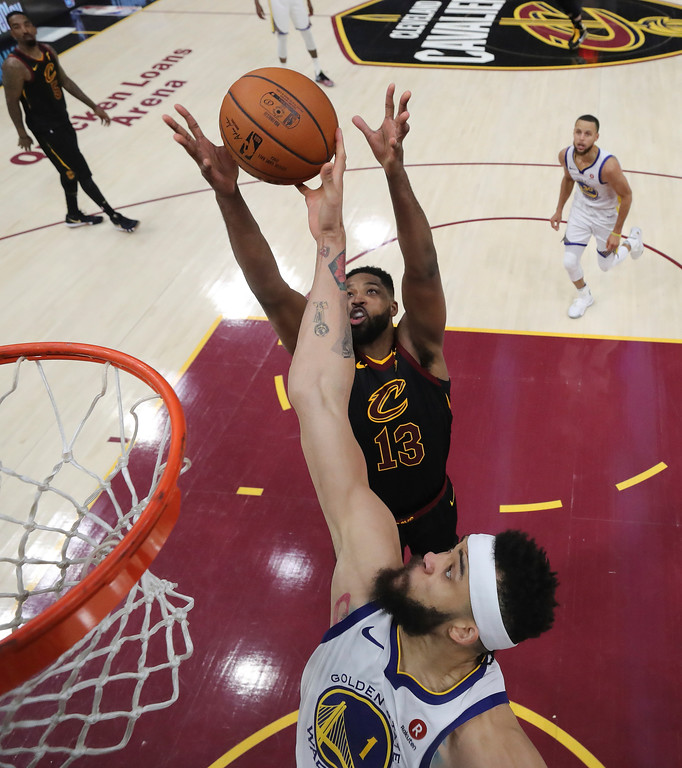 . Cleveland Cavaliers\' Tristan Thompson (13) and Golden State Warriors\' JaVale McGee reach for a rebound during the second half of Game 4 of basketball\'s NBA Finals, Friday, June 8, 2018, in Cleveland. (Kyle Terada/Pool Photo via AP)