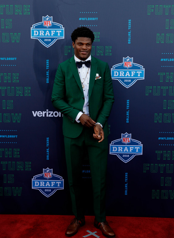 . Louisville\'s Lamar Jackson walks the red carpet before the first round of the 2018 NFL football draft, Thursday, April 26, 2018, in Arlington, Texas. (AP Photo/Eric Gay)