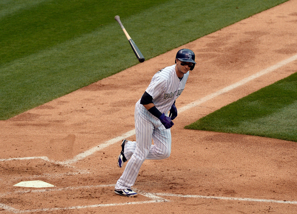 . DENVER, CO - MAY 22: Colorado Rockies shortstop Troy Tulowitzki (2) flips his bat as he reaches first base on a walk in the 4th inning against the San Francisco Giants May 22, 2014 at Coors Field. (Photo by John Leyba/The Denver Post)