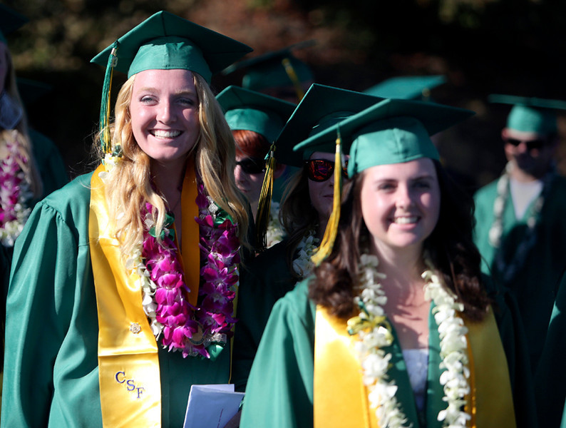 . Harbor High seniors march in line towards the Cabrillo College football field in Aptos on Friday evening during the 2013 graduation ceremony. (Kevin Johnson/Sentinel)