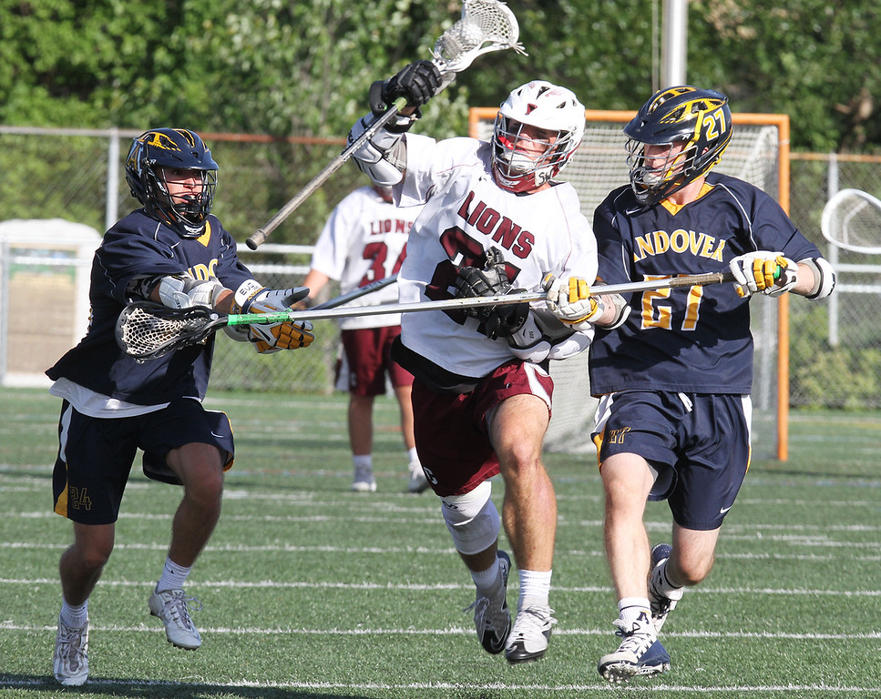 . Chelmford vs Andover boys lacrosse. Chelmsford\'s Sal Lupoli (21), center, and Andover\'s Joe Hoar (24), left, and Kevin Flowers (27), right. (SUN/Julia Malakie)