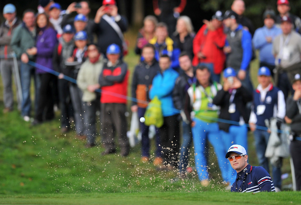 . Zach Johnson of Team US plays from a bunker on the fifteenth hole during the singles matches at Gleneagles in Scotland, on September 28, 2014, during the 2014 Ryder Cup competition between Europe and the USA.  AFP PHOTO / GLYN KIRK