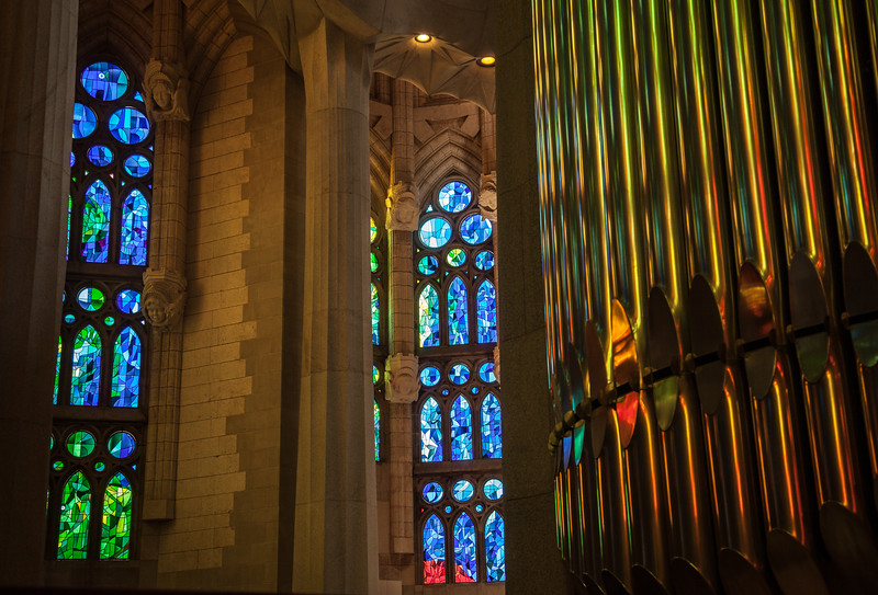 Stained glass reflecting off pipe organ