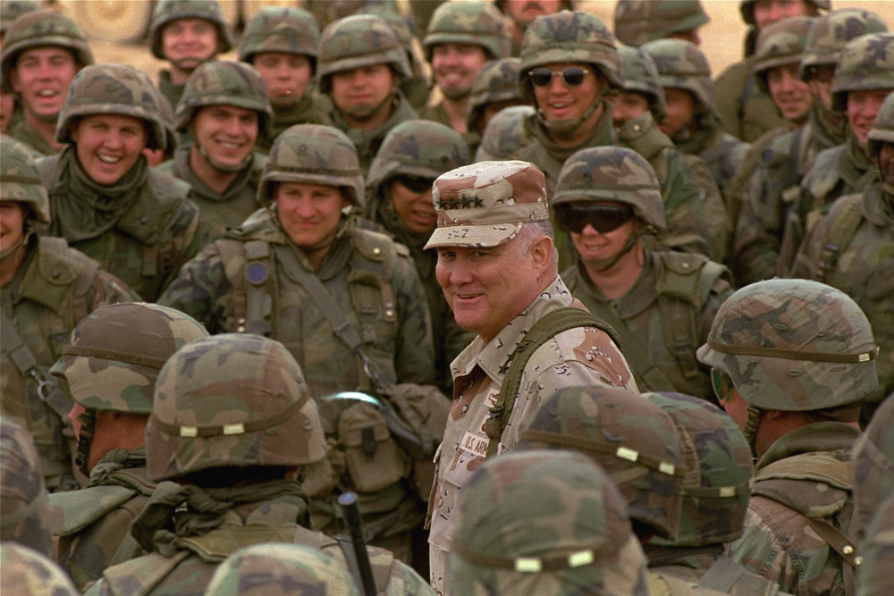 . General H. Norman Schwarzkopf, 6 foot 3 inch, 230 pound, four-star general stands out among soldiers of the 1st Infantry Division during a visit to the troops in the Saudi Arabian desert Saturday. (AP Photo)