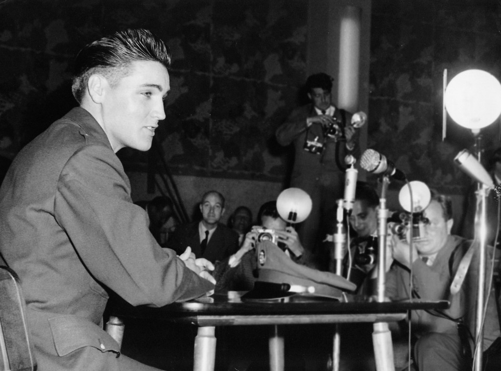 . Elvis Presley news conference - The American singer-turned-soldier is shown during press conference at Friedberg/West Germany on Oct. 2, 1958. He has been assigned to the 3rd armoured (sparehead) division at Friedberg. (10/02/1958)(AP Photo/Lindlar)