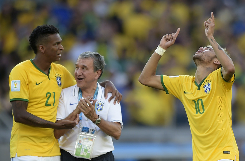 . (From L-R) Brazil\'s forward Jo, a member of the Brazilian coaching team and Brazil\'s forward Neymar celebrate after they won their match against Chile in a penalty shoot out after extra-time in the Round of 16 football match at The Mineirao Stadium in Belo Horizonte during the 2014 FIFA World Cup on June 28, 2014. (JUAN MABROMATA/AFP/Getty Images)