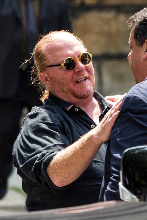 . Chef Mario Batali leaves after attending the funeral for Actor James Gandolfini at The Cathedral Church of St. John the Divine on June 27, 2013 in New York City.   (Photo by Andrew Burton/Getty Images)