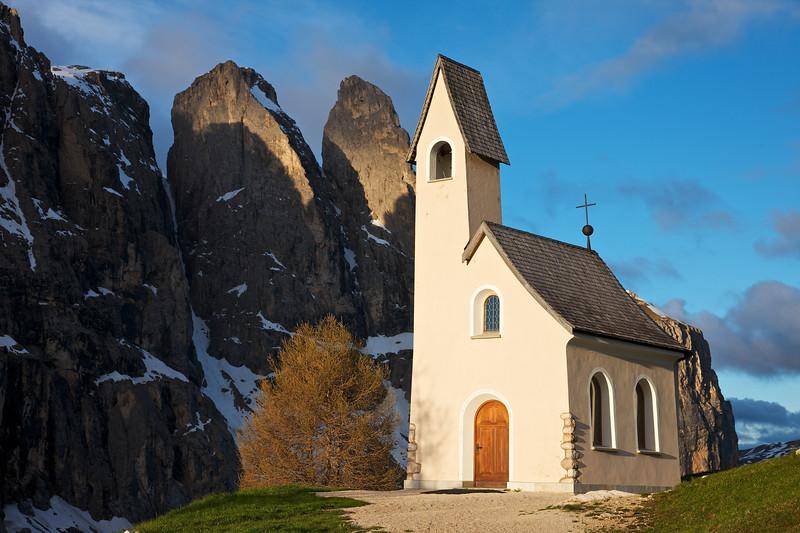 Church and Dolomite Peaks at Gardena Pass, Dolomites, Italy.