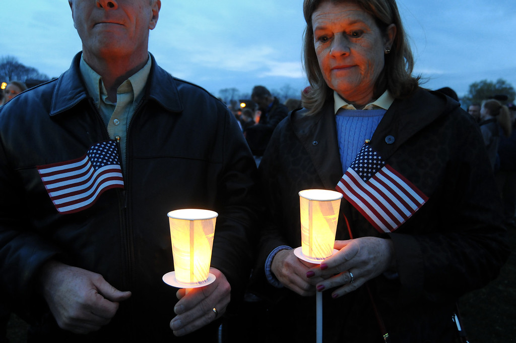 . Tom and Nancy Gallagher attend a vigil ceremony  April 16, 2013 in Dorcester, Massachusetts honoring the Richard family, who\'s 8-year-old son Martin was killed,  sister Jane, who lost a leg, and mother Denise, who was also seriously injured when bombs exploded at the finish of the Boston Marathon April 15th.   JOHN MOTTERN/AFP/Getty Images