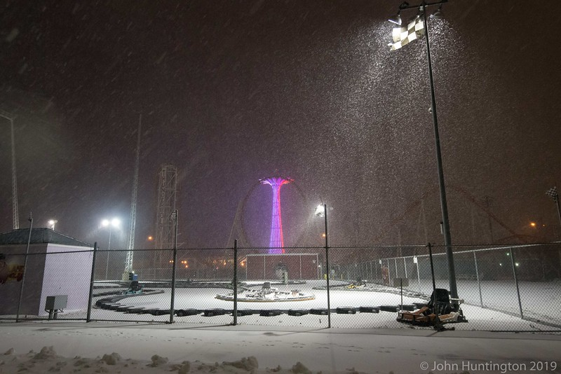 BROOKLYN, NY/USA – JANUARY 26 2015: Heavy wind driven snow falls on Coney Island's amusement district.
