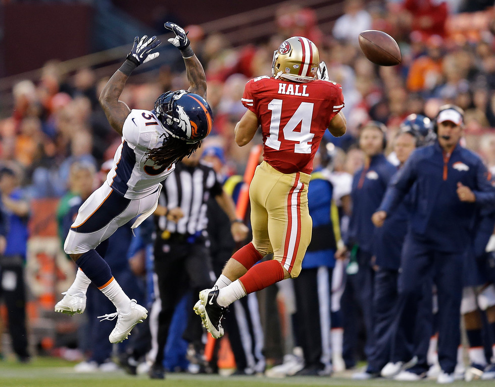 . Denver Broncos cornerback Omar Bolden, left, misses a pass intended for San Francisco 49ers wide receiver Chad Hall, right, during the third quarter of an NFL preseason football game on Thursday, Aug. 8, 2013, in San Francisco. (AP Photo/Ben Margot)
