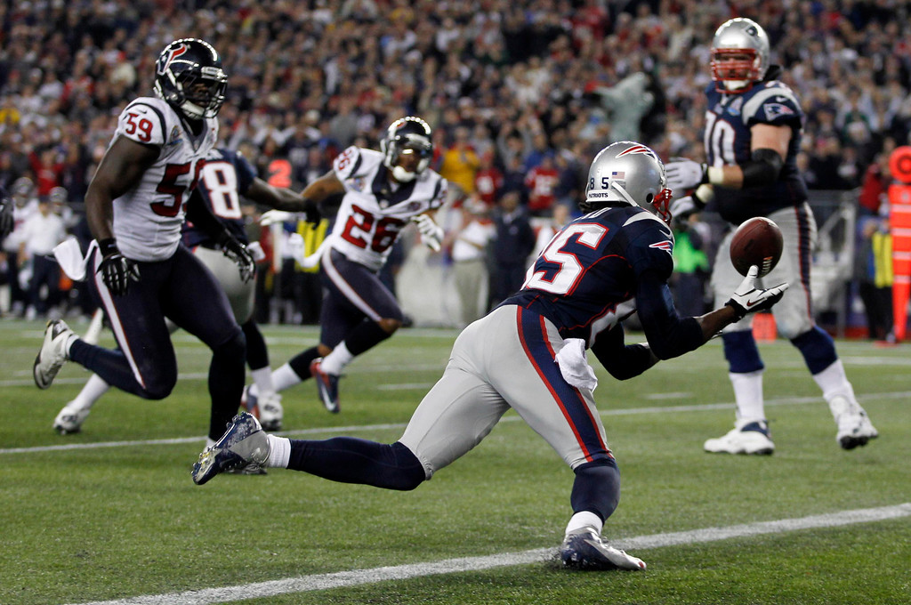 . New England Patriots wide receiver Brandon Lloyd recovers a fumble in the end zone for a touchdown against the Houston Texans during the second half of their NFL football game in Foxborough, Massachusetts December 10, 2012.  REUTERS/Jessica Rinaldi