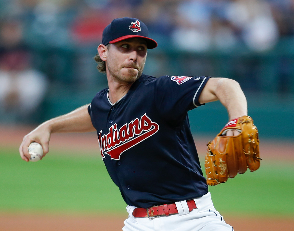 . Cleveland Indians starting pitcher Josh Tomlin delivers against the Minnesota Twins during the first inning in a baseball game, Tuesday, Sept. 26, 2017, in Cleveland. (AP Photo/Ron Schwane)