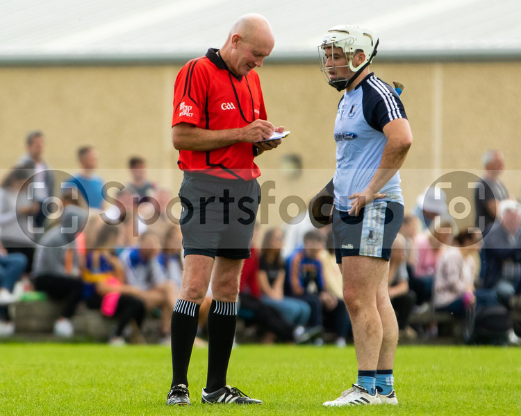 match referee Ciaran Timmons and Nenagh Eire Og's Donnacha Quinn