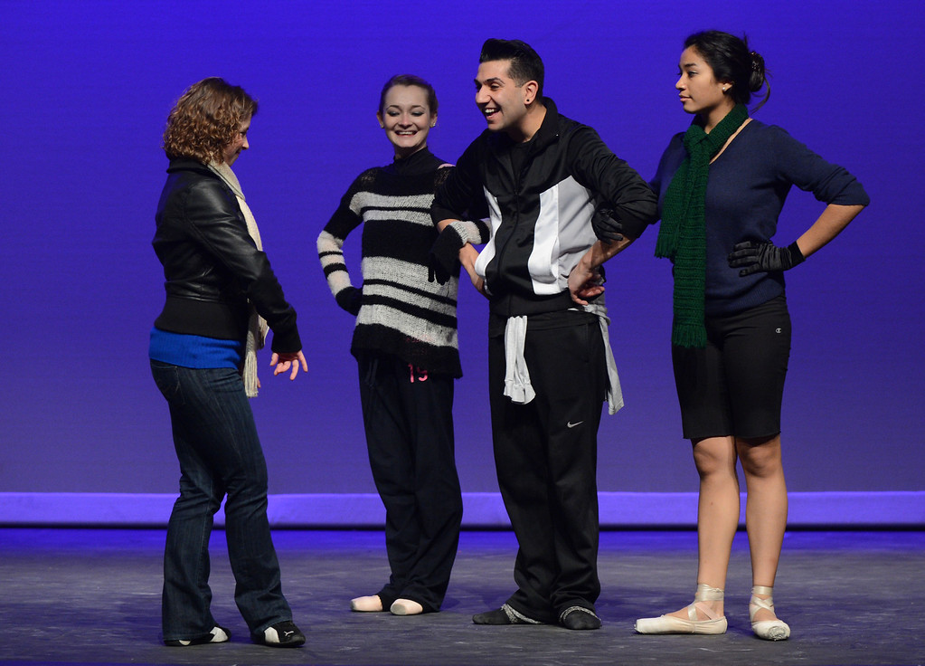 . Sharon Sobel, left, artistic director with Black Diamond Ballet Theatre speaks with dancers Alexandra Lengyel of Brentwood,  Ricky Navarro of Pittsburg, and Andrea Herrera of Antioch, during a dress rehearsal in preparation for the Jan. 19 opening gala at the restored California Theatre in Pittsburg, Calif. on Tuesday, Jan. 15, 2013.   (Susan Tripp Pollard/Staff)