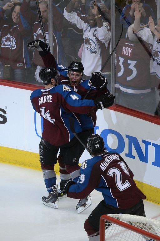 . Paul Stastny (26) of the Colorado Avalanche celebrates his game-winning goal with teammates Tyson Barrie (4) and Nathan MacKinnon (29) during the overtime period of the Avs\' 5-4 win. The Colorado Avalanche hosted the Minnesota Wild during the first round of the NHL Stanley Cup Playoffs at the Pepsi Center on Thursday, April 17, 2014. (Photo by Karl Gehring/The Denver Post)