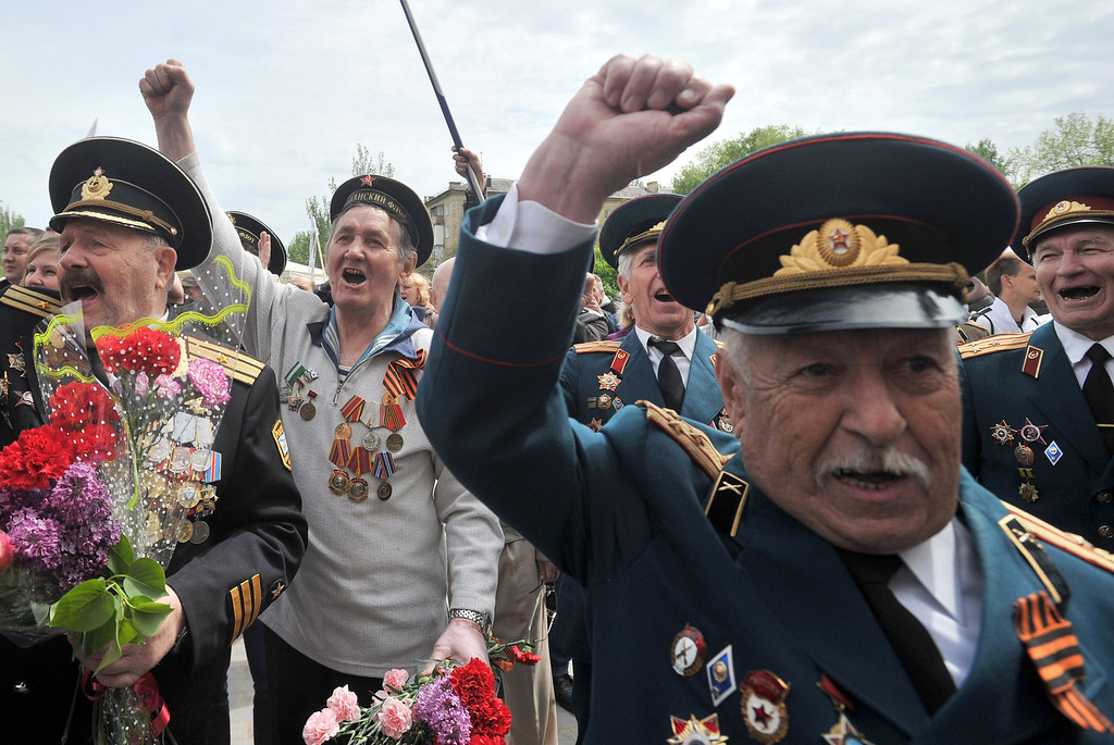 . Retired Soviet army officers shout slogans as people gather outside the regional state building seized by pro-Russia separatists to mark Victory Day in the eastern Ukrainian city of Donetsk on May 9, 2014.  AFP PHOTO/ GENYA SAVILOV/AFP/Getty Images