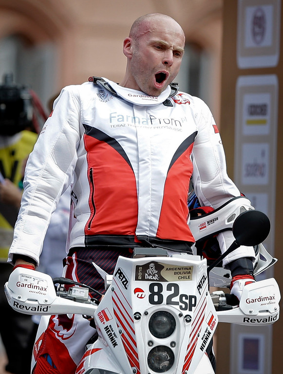 . In this Sunday, Jan. 4, 2015 photo, Poland\'s Michal Hernik gestures for photographers as he crosses the ramp during the symbolic start of the Dakar Rally 2015 in Buenos Aires, Argentina. According to race authorities, Hernik, 39, was found dead on Tuesday, Jan. 6, 2015 during the third stage of the race between the Argentine cities of San Juan and Chilecito. The circumstances of his death have not yet been determined, and his death is the first in this year\'s Dakar rally. It was Hernik\'s first time participating in the race. (AP Photo/Natacha Pisarenko)