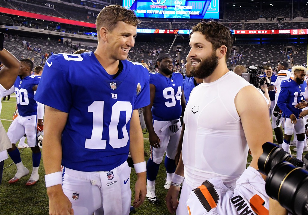 . New York Giants quarterback Eli Manning (10) talks to Cleveland Browns quarterback Baker Mayfield after a preseason NFL football game Thursday, Aug. 9, 2018, in East Rutherford, N.J. (AP Photo/Bill Kostroun)