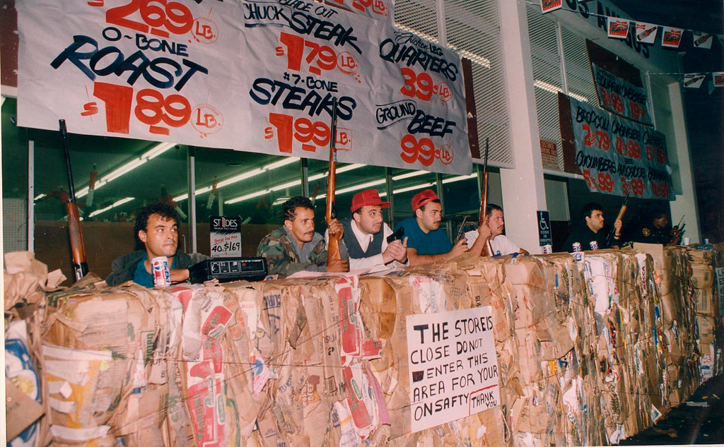 . Workers at a Hawthorne grocery store stand guard behind paper bales during L.A. Riots to protect their store. Daily Breeze file photo