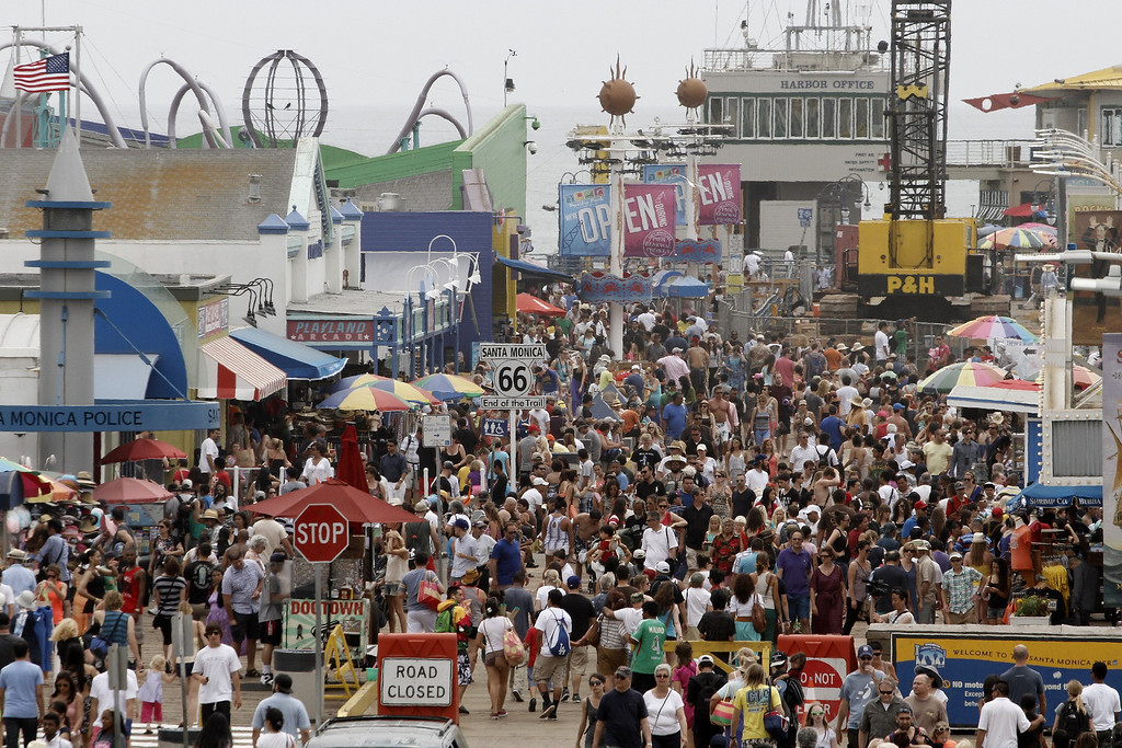 . People crowd Santa Monica Pier in Santa Monica, California, June 30, 2011, amid the heat wave gripping the southwest US.    JONATHAN ALCORN/AFP/Getty Images